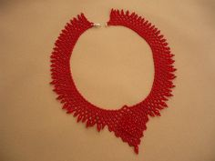 Beautiful dark red- crystal beadwork choker necklace. I used czech glass seed beads, teardrop and rondell crystal beads for this necklace. The length of the necklace with clasp is 42,5 cm (16.73 in), width: 3,5 cm (1,38 in), at the fron point 7 cm (2.76 in). This jewelry is a luxury