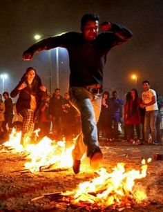 Iranians jump over burning bonfires celebrating the arrival of spring which coincides with their new year, or Nowruz, which began on March 21.