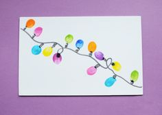 Thumbprint Christmas Lights Card/Gift Tag. Could draw the string and have kids add thumbprints during drill and practice.