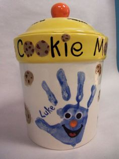 Does your Mom or Grandma make the BEST cookies? Surprise her with a fun cookie jar painted by YOU for a Mother's Day gift you'll both enjoy. Check out this fun cookie monster handprint sample at our studio.