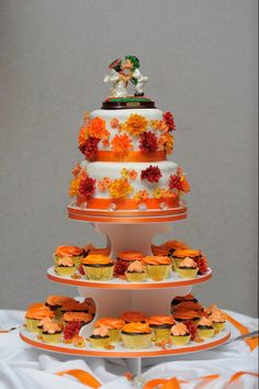 A small wedding cake and cupcakes for a fall wedding. Chocolate cake and buttercream frosting.