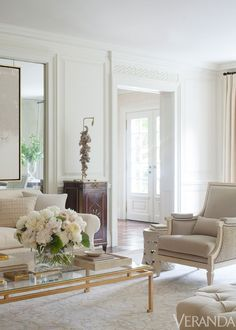 White and beige living room, I really like the gold table!