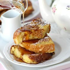 Oh, my. Look at those thick slices of French Toast dusted with confectioners' sugar and served with maple syrup and fruit. Made with da...