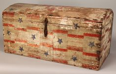 """Patriotic folk art decorated trunk with Federal Eagle on dome trunk, border of stars and red stripes, red ribbon and blue star decoration around front and sides of trunk. 13 1/2"""" H x 27"""" L x 13 7/8"""". Mid to late 19th century. Provenance: estate of A. Welling LaGrone, Jr., Nashville, Tenn."""