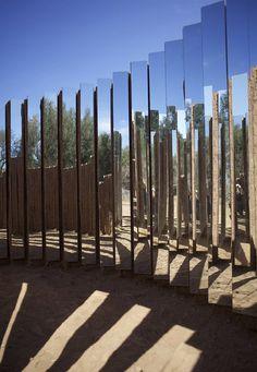 mud brick and mirror spiral installation by elin hansdottir