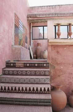 Pastel pink moroccan decor / building / architecture. Millennial Pink patterned tile stairs.