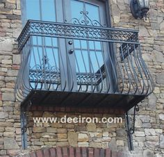 Beautiful and elegant Juliet balcony for your home. Looks great on brick! Juliet balcony, wrought iron balcony, decorative balcony, french doors, elegant home design, iron railings
