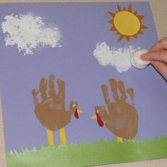 A cotton ball is used to paint puffy clouds - Photo © Apryl Duncan