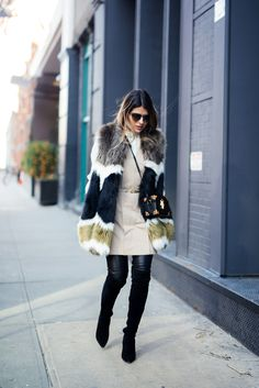 Pam Hetlinger wearing a dawn levy fur coat, black over the knee boots, and khaki shift dress. new york fashion week.