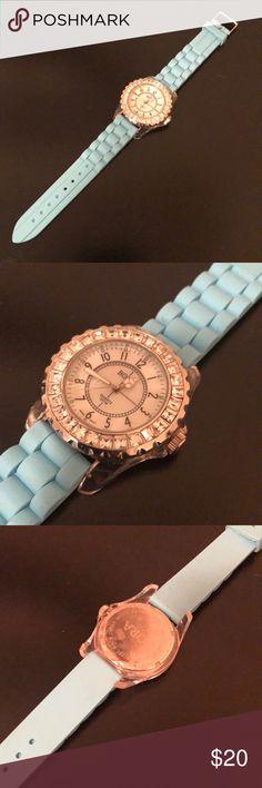 WATCH WITH RHINESTONE BEZEL AND RUBBER BAND WATCH WITH RHINESTONE BEZEL AND RUBBER BAND  Baby blue rubber band. Needs new battery. Accessories Watches