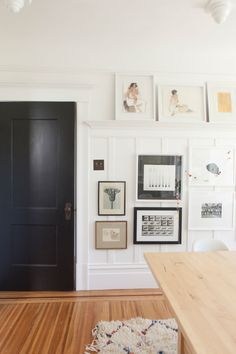 We created a black and white artwork gallery wall in our dining room (see the makeover and...