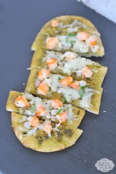 This herbed shrimp pesto pizza is the perfect weeknight meal that is ready in only 20 minutes!