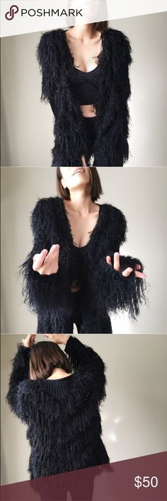 "Glamorous black tier faux fur cardigan. Look glamorous in this faux fur shaggy cardigan . With hook eye closure. Tier faux fur. Fabric content; 60%acrylic 30%nylon 29%polyester. Long drapy grunge look. Punk, gothic, or glamorous style. Size S: bust40"", length 27"". Size M : bust 41"", length 27.5"". Size L : bust42"", length 38"". PRICE IS FIRM unless Bundle for 10% discount. CHICBOMB  Jackets & Coats"