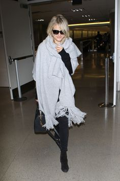 Alessandra Ambrosio's Raw-Hem Flares are Perfect at the Airport  - ELLE.com