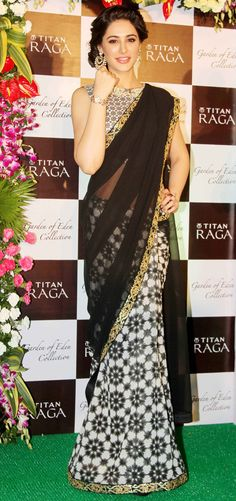 Nargis Fakhri in a stunning black saree by SVA at a Titan Raga event. #Bollywood #Fashion #Style #Beauty
