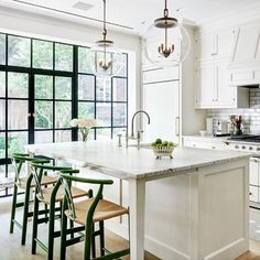 Open kitchen w good lighting and lots of windows by  pencilandpaperco's photo on Instagram