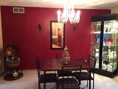 Rag rolled dining room wall : base color oriental berry by Glidden, top rag rolled with classic burgundy