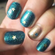Sparkle teal turquoise gold star glitter accent nail art design