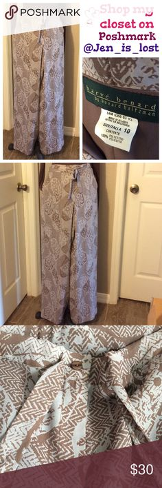 "Printed Pants 10 Tags torn but never wore, bought for my mother while she was staying with me and I bought her the wrong size.  These are drawstring with zipper and button up.  Size is a 10 waist measures 18"" laying flat and remember this has the drawstring waist so can be tightened to fit smaller if needed.  Inseam is 31"". Perfect for the fall, just bought less than a month ago if I did not throw away the receipt I would go get my money back.  My loss your gain. Harve Benard Pants"