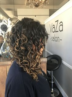 Curly hair style with highlights