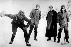 Soldiers of the German Wehrmacht are pictured doing sports. Place unknown. On the back of the image is dated 24 February 1942: In the East. The troops who are not active entertain themselves during forced breaks on the defense front in winter. Curling after an empty can. Photo: Berliner Verlag/Archiv