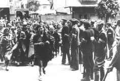Lithuanian militia force Jewish women to march to their humiliation and murder in Kaunas (Kovno) in 1941.