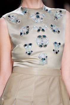 Pale gold top adorned with oversized jewel embellishments in watery blue colours; fashion details // Christian Dior