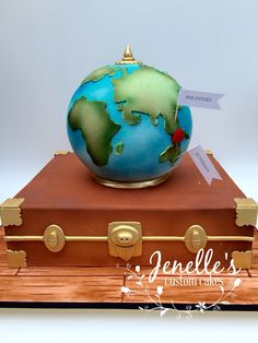 Suitcase and world globe cake. By Jenelle's Custom Cakes.                                                                                                                                                      More