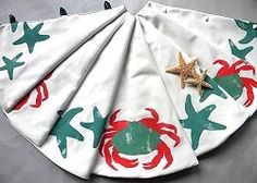 """. Measures 54 inches in diameter, and will accommodate up to 4 1/2"""" diameter tree trunk. Hand made in the USA. Coordinating Christmas Stockings are also available. Please allow 2-3 weeks for delivery. We recommend ordering by Dec. 1st to ensure delivery by Christmas. #HH-CB04-SKHoliday Crabs Christmas Tree Skirt"""