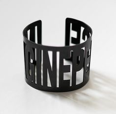 Need/Want    IMAGINE PEACE Bracelet - Black Oxide plating on steel - $80 - All proceeds from the sale of the bracelet are dedicated to supporting and encouraging female entrepreneurship.