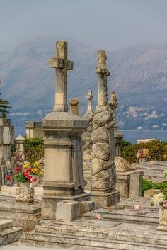 Old traditional cemetery in Cavtat, small town near Dubrovnik, Croatia. Cavtat is one of the most beautiful towns in Croatia, it is on the Adriatic Sea coast 15 kilometres south of Dubrovnik. Cavtat Croatia, Dalmatia Croatia, Dubrovnik Croatia, Croatia Travel, Cemetery Monuments, Cemetery Art, Split Second, Wedding Activities, Paradise On Earth