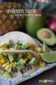 Chicken Tacos with Mango-Pineapple Salsa // Looking for a meal to feed your family in less than 30 minutes? These tacos are made easy with pre-cooked shredded rotisserie chicken. Add mango-pineapple salsa and you've got a delicious healthy meal perfect for any weeknight or weekend dinner | Tried and Tasty