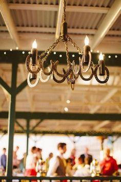 Horseshoe wedding chandelier / http://www.deerpearlflowers.com/rustic-farm-wedding-horseshoe-ideas/