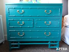 Love the peacock blue color of this faux bamboo dresser.