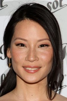 Lucy Liu: Her beauty secrets to black silky hair is, she never dyes it!! Her beautiful skin tip is drinks a lot of water and no caffeine.