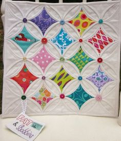 Idea to cover the connections on Cathedral Window blocks (which are often just a little bit wonky) with buttons. mini by yayaquilter, via Flickr mini-quilts