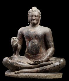 This sculpture is a masterful realization of Buddhist dharma. It must have graced one of the major monasteries of Angkor Borei, a leading urban center of Funan. The Buddha is seated in yogic meditation, one leg resting on the other