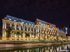 Illuminated Palace of Justice in Bucharest, Romania, reflected in Dambovita river by night Get 10 free images - 1 month free trial #bucharest #architecture #building #nightphotography #river #dambovita #reflections #history #justice #historical Bucharest Romania, 1 Month, Night Photography, Free Images, Palace, Urban, River, Stock Photos, Explore