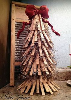 clothespin christmas tree, christmas decorations, repurposing upcycling, seasonal holiday decor, This little tree started out with an empty paper towel roll and ended up looking so adorable Beach Christmas Trees, Pallet Christmas Tree, Christmas Time, Christmas Crafts, Christmas Decorations, Christmas Ornaments, Holiday Decor, Xmas, Christmas Popcorn