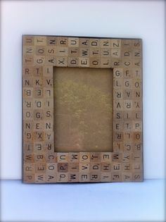 Scrabble letters picture frame. *Another cute decor item for game room. However, instead of going in totally random order, I'd do it in hidden word style, maybe putting in the names of those in the picture, where it was taken, date, etc., then filling it in with random letters. Also, align letters all in same direction.