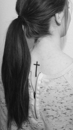 Simple cross tattoo on back