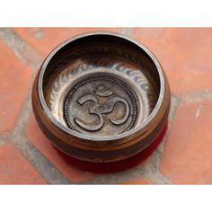 Om Etched Singing Bowl 11 Cm Nepal ($39) ❤ liked on Polyvore featuring home, home decor, baskets & bowls, dark olive, home & living, home décor, music bowl, outside home decor, music home decor and heart shaped bowl