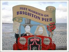 Just Married on Brighton Pier - cut out photographic board: the owners changed the sign from Palace Pier in 2000 (an informal name change not recognised by the National Piers Society or many Brightonians). The full name of the pier is 'Brighton Marine and Palace Pier'