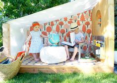 Cute outdoor book nook by @mermag - the perfect place to read to your little ones on warm, summer days!