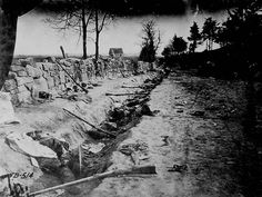 Confederate dead behind the stone wall of Marye's Heights, Fredericksburg, Va., killed during the Battle of Chancellorsville, May 1863
