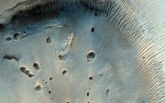Pitted Mound in Northeast Arabia Terra