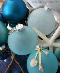 Bring a bit of the beach inside this Christmas with these beautiful and easy to make Sea Glass Ornaments, first seen on Sand & Sisal.