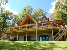 The appeal of this newly constructed log home is hard to miss. With a large back deck to enjoy the stunning lake front view and a beautifully furnished interior friends and family will feel right at home. The main level ...