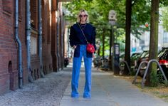 Details on lisarvd.com   Lisa Hahnbück wearing a total Victoria, by Victoria Beckham look:  Midnight Blue Ruffled Knit, Flared Jeans with Contrast Pockets, Red Chloé Drew Bag, Fendi Jungle Sunglasses, Ariane Ernst Jewelry Necklace and Platform Heels