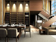 LOVE this great dining area – featuring two Vintec 'NOIR' V190SG2EBK wine cellars.